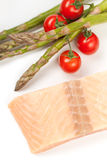 Raw salmon steak and vegetables Royalty Free Stock Images