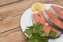 Raw salmon steak on white dish Stock Photo