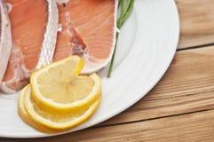 Raw salmon steak on white dish Royalty Free Stock Photo