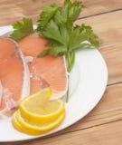 Raw salmon steak on white dish Stock Photography