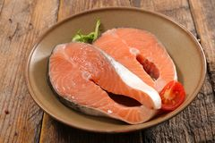 Raw salmon steak. On wood Stock Photography