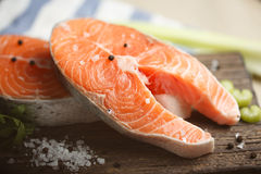Raw salmon steaks, close-up. Fresh salmon steaks on a wooden cutting board, close up Royalty Free Stock Photo