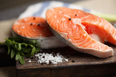 Raw salmon steaks close-up. Fresh salmon steaks on a wooden cutting board, close up Royalty Free Stock Image