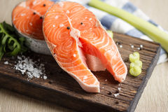 Raw salmon steaks. Fresh salmon steaks on a wooden cutting board, close up Royalty Free Stock Photography