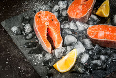 Raw salmon steaks on ice Royalty Free Stock Images