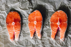 Raw Salmon Steaks on Parchment Paper. View from Above Royalty Free Stock Image