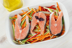 Raw salmon steaks with vegetables Stock Images