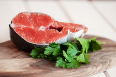 Raw salmon steaks on the wooden board.  Royalty Free Stock Photo