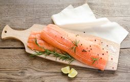 Raw salmon steaks on the wooden board Stock Images