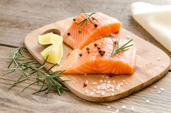 Raw salmon steaks on the wooden board Royalty Free Stock Photos