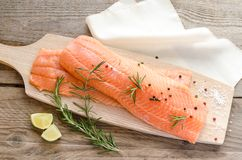 Raw salmon steaks on the wooden board Royalty Free Stock Photo
