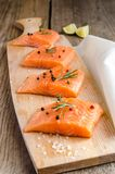 Raw salmon steaks on the wooden board Stock Photos
