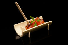 Raw salmon fillet with spices on bamboo Royalty Free Stock Image