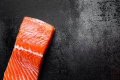 Raw salmon or trout sea fish fillet on black metal background, top view Stock Photo