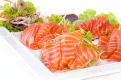 Raw salmon with wasabi and sauce isolated on white plat. E on white background Stock Photography
