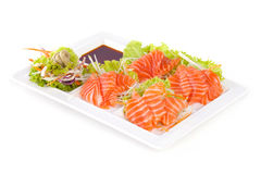 Raw salmon with wasabi and sauce isolated on white plate. On white background Royalty Free Stock Photo