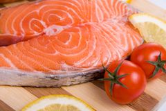 Raw salmon on a wooden board.  Stock Photo