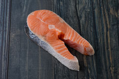 Raw salmon on a wooden board. Closeup Royalty Free Stock Images