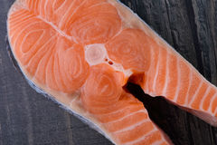 Raw salmon on a wooden board. closeup Royalty Free Stock Photos