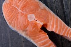 Raw salmon on a wooden board. closeup. Fresh salmon on a wooden board. closeup Royalty Free Stock Photos