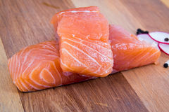 Raw salmon on a wooden board Royalty Free Stock Photography
