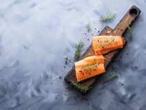 Raw salmon on wooden board with herbs Royalty Free Stock Images