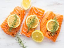 Raw salmon on wooden board with herbs Stock Image