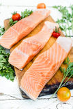 Raw salmon. On the wooden board,selective focus Stock Photo