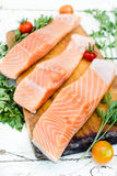 Raw salmon. On the wooden board,selective focus Stock Image