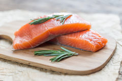Raw salmon on the wooden board Royalty Free Stock Photography