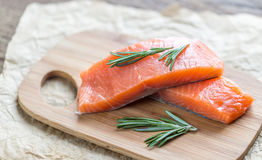 Raw salmon on the wooden board Royalty Free Stock Image