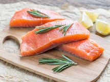 Raw salmon on the wooden board Stock Photography