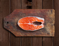 Raw salmon on wooden cutting board Royalty Free Stock Image