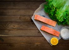 Raw salmon on wooden table Royalty Free Stock Photography