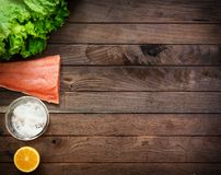 Raw salmon on wooden table Royalty Free Stock Photos