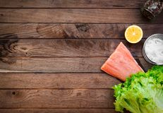 Raw salmon on wooden table Stock Photo