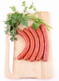 Raw sausage. Raw sausage and parsley on white background Royalty Free Stock Images