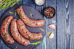 Raw sausage of beef and pork with spices Stock Photo