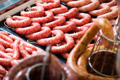 Raw sausage on counter. In supermarket, close up Stock Photo