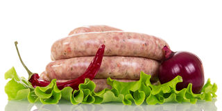 Raw sausage meat, lettuce, onion and pepper isolated on white. Raw sausage meat, lettuce, onion and pepper isolated on white background Royalty Free Stock Photo