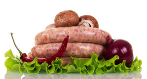 Raw sausage, mushrooms, lettuce, red pepper and onion . Raw sausage, mushrooms, lettuce, red pepper and onion  on white background Stock Photo