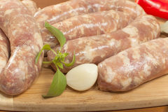 Raw sausage in the shell Royalty Free Stock Photos