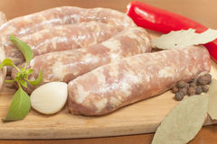 Raw sausage in the shell Stock Photos