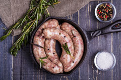 Raw sausage with spices Royalty Free Stock Images