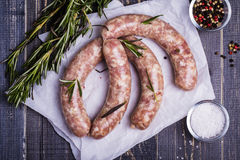 Raw sausage with spices Royalty Free Stock Image