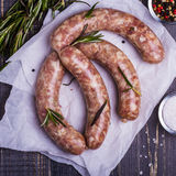 Raw sausage with spices Stock Images