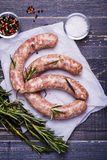 Raw sausage with spices Stock Photography