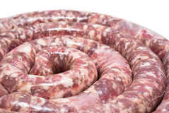 Raw sausage- spiral Royalty Free Stock Photos