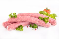 Raw sausage. On white Stock Images