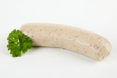 A raw sausage. With white background Stock Image